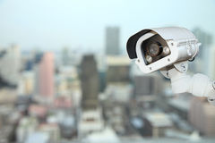 CCTV with Blurring City in night background. Royalty Free Stock Image
