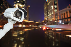 CCTV with bokeh blurring city in night background. Royalty Free Stock Image