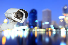CCTV with bokeh blurring city in night background. Royalty Free Stock Photos