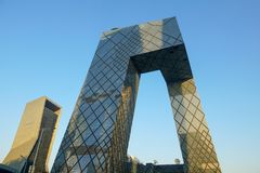 The CCTV Tower of Beijing, China. CCTV Headquarters during blue day in Beijing. The CCTV building is a loop of six horizontal and vertical sections with a total royalty free stock images