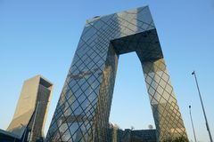 The CCTV Tower of Beijing, China. CCTV Headquarters during blue day in Beijing. The CCTV building is a loop of six horizontal and vertical sections with a total stock photo