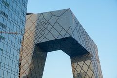 The CCTV Tower of Beijing, China. CCTV Headquarters during blue day in Beijing. The CCTV building is a loop of six horizontal and vertical sections with a total stock images