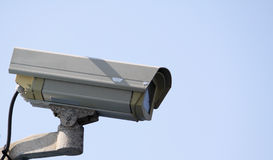 Cctv camera. Cctv security camera on a blue sky background showing signs of weathering Stock Photos