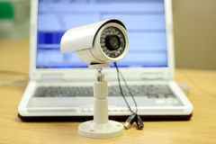 CCTV camera. A cctv camera in front of a laptop