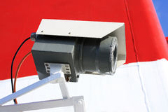 Cctv camera. On red and white background Royalty Free Stock Photo