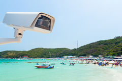 Cctv camera with beach background Stock Photo