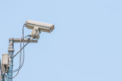 Cctv camera. On blue sky background Royalty Free Stock Photo