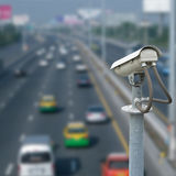 CCTV camera with blur traffic road background Royalty Free Stock Image
