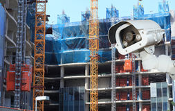 CCTV camera with Blurring Building construction background. Stock Photo