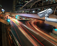 CCTV camera with blurring the night city in background. stock photography