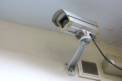 a cctv camera in the building stock images