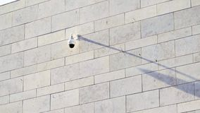 CCTV camera on building wall