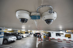 Cctv camera in car park building. stock photos