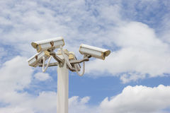 CCTV Camera in cloudy blue sky background Stock Images