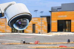 CCTV camera construction site. Security CCTV camera or surveillance system with construction site on blurry background Stock Image