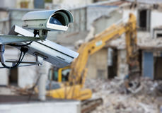 CCTV camera construction site. Security CCTV camera or surveillance system with construction site on blurry background Stock Photos