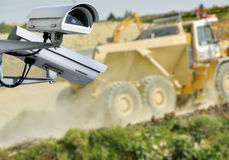 CCTV camera construction site. Security CCTV camera or surveillance system with construction site on blurry background Royalty Free Stock Images