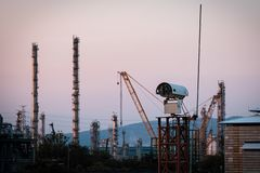 Free CCTV Camera For Security In Factory And Storage Tank At Sunset Time..silhouette Security Camera In Petrochemical Plant Stock Photos - 159272633