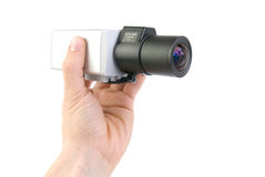 Cctv camera in hand. On white background stock images