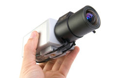 Cctv camera in hand. On white background royalty free stock images