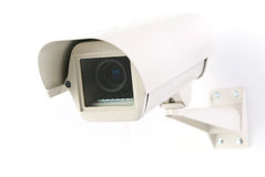 Cctv camera in housing. Cctv camera in white background royalty free stock image