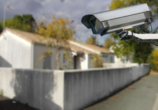 CCTV camera with individual house. Security CCTV camera or surveillance system with individual house on blurry background royalty free stock photography