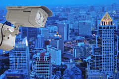 cctv camera isolated on white background with modern building bl Royalty Free Stock Images