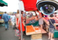 CCTV camera on local market. Security CCTV camera or surveillance system with local market on blurry background Stock Images