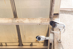CCTV camera mounted on the ceiling and wall. Stock Photography