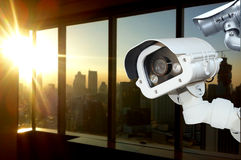 CCTV camera operating inside office window . Royalty Free Stock Image