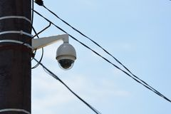CCTV camera on a pillar in the city against the sky.  royalty free stock images