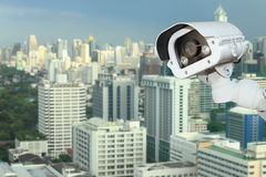 CCTV camera security with blurring city background . Royalty Free Stock Images