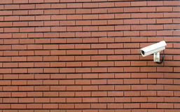Cctv camera. Cctv security camera on the brick wall with plenty of copy space Royalty Free Stock Photo