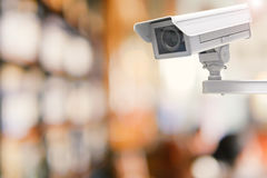 Cctv camera or security camera on retail shop blurred background Stock Image