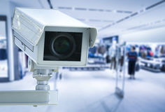 Cctv camera or security camera on retail shop blurred background. 3d rendering cctv camera or security camera on retail shop blurred background Stock Photography