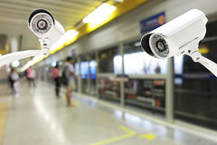 CCTV Camera security operating on subway station platform Stock Photo