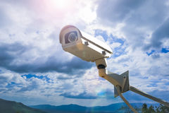 CCTV camera security outdoor on the sky. Royalty Free Stock Photos