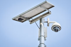 CCTV camera security. With Solar panel in a big city Stock Photo