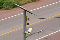 CCTV camera security. With Solar panel and street lamp in a big city (All in one Royalty Free Stock Photography