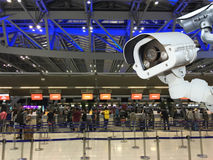 CCTV camera security or surveillance operating in air port. Stock Photography