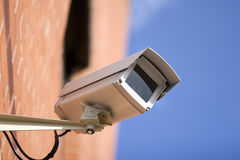 CCTV Camera On The Side Of Building Stock Images