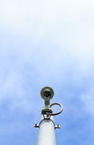 Cctv camera on sky with clouds Royalty Free Stock Images