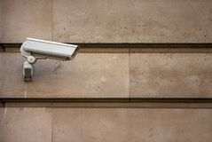 CCTV camera on stone-clad wall Stock Photography