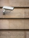 CCTV camera on stone-clad wall Royalty Free Stock Photos