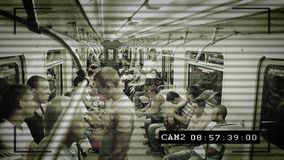 CCTV camera in subway train, people being watched, big brother stock video footage