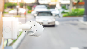 CCTV camera surveillance on car parking Safety system area control with flare light and copy space royalty free stock image