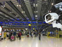 CCTV camera or surveillance operating in air port. Royalty Free Stock Photo