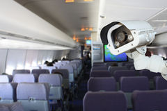 CCTV camera or surveillance operating in airplane. Royalty Free Stock Photo