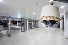 CCTV camera or surveillance operating. In building entrance Royalty Free Stock Images