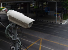 CCTV camera or surveillance operating on traffic. Road Royalty Free Stock Image
